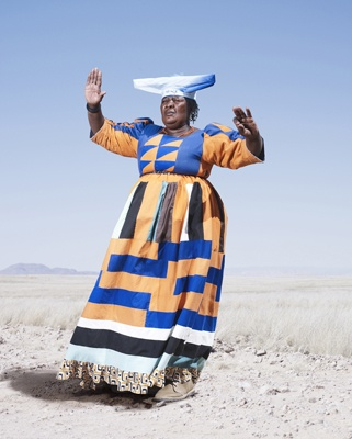 Jim Naughten - Conflict and Costume Herero Woman in Orange Dress (2012)